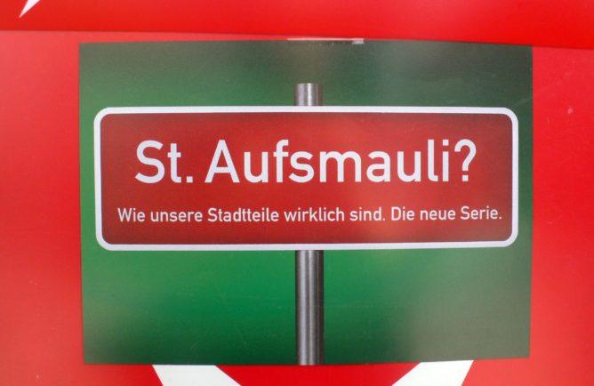 Plakat St. Aufsmauli, am Kiosk gesehen